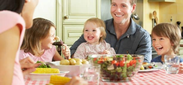 Nutrition Course graduate eating healthy food with family